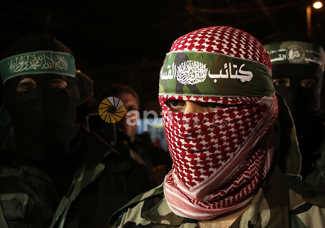 Abu Obeida, a spokesman for Hamas's armed wing the Ezzedine Al-Qassam Brigade, holds a press conference in Gaza City on March 26, 2010. Two Israeli soldiers, including an officer, and two Palestinians were killed in an exchange of fire near the border with the Gaza Strip, an army spokesman said. Ezzedine al-Qassam Brigade claimed responsibility for the attack . Photo by Mohammed Asad