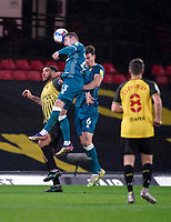 Kenny McLean of Norwich City wins the header with Troy Deeney of Watford during the Sky Bet Championship behind closed doors match played without supporters with the town in tier 4 of the government covid-19 restrictions, between Watford and Norwich City at Vicarage Road, Watford, England on 26 December 2020. Photo by Andy Rowland.