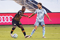 KANSAS CITY, UNITED STATES - AUGUST 25: Darwin Quintero #23 of Houston Dynamo with the ball against Graham Zusi #8 of Sporting Kansas City  a game between Houston Dynamo and Sporting Kansas City at Children's Mercy Park on August 25, 2020 in Kansas City, Kansas.