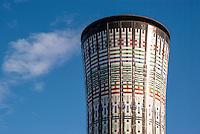 """Milano, zona Isola - Garibaldi. La torre Arcobaleno, serbatoio dell'acqua della stazione ferroviaria Garibaldi coperta di piastrelle colorate --- Milan, Isola - Garibaldi area. The """"Rainbow"""" water tower of Garibaldi railway station covered with colored tiles"""