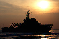The silhouette of a beached ship. India.