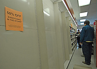 A customer browses the remaining books on the nearly empty racks at a Westerville, Ohio, bookstore on the final day of sales at the suburban store. The store, one of the smallest in the B. Dalton chain, was closing after nearly two decades tucked in the corner of a building housing an insurance company and a balloon store.(Gary Gardiner/EyePush Newsphotos)<br />