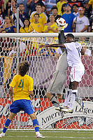 Brazil goalkeeper Victor (1) and Edson Buddle (14) of the United States battle for the ball. The men's national team of Brazil (BRA) defaeted the United States (USA) 2-0 during an international friendly at the New Meadowlands Stadium in East Rutherford, NJ, on August 10, 2010.