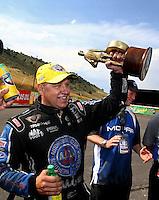 Jul. 20, 2014; Morrison, CO, USA; NHRA funny car driver Robert Hight celebrates after winning the Mile High Nationals at Bandimere Speedway. Mandatory Credit: Mark J. Rebilas-