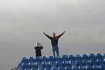 Faroe Islands 0 Scotland 2, 06/06/2007. European Championship Qualifier. A Scotland fan celebrating his team's victory on an embankment behind the goal at the end of the Faroe Islands match with Scotland in a Euro 2008 group B qualifying match at the Svangaskard stadium in Toftir. The visitors won the match by 2 goals to nil to stay in contention for a place at the European football championships which were to be held in Switzerland and Austria in the Summer of 2008. It was the first time Scotland had won in the Faroes, the previous two matches ended in draws. Photo by Colin McPherson.