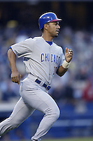 Moises Alou of the Chicago Cubs runs the bases during a 2002 MLB season game against the Los Angeles Dodgers at Dodger Stadium, in Los Angeles, California. (Larry Goren/Four Seam Images)
