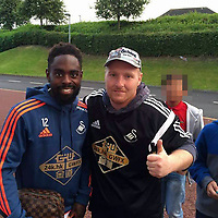 "Pictured: Steve Owen (R), the brother of Sarah Owen, pictured with footballer Nathan Dyer. IMAGE TAKEN FROM OPEN SOCIAL MEDIA ACCOUNT ACCOUNT.<br /> Re: A mum whose two triplets died mysteriously was hit by fresh heartbreak yesterday(fri) when her brother was found dead.<br /> Sarah Owen, 29, was left ""numb with shock"" when father-of-five Steve Owen died of a suspected heart attack.<br /> Friends said Sarah and her family were unable to comprehend the treble tragedy in just 10 days.<br /> Steve, who would have been 32 yesterday(fri), was in tears when nephews Noah and Charlie died in their sleep.<br /> He put a picture of the two little boys on his Facebook page and helped raise money for their funerals.<br /> But before the funerals have been held Steve was found dead on the settee of his home in Bridgend, South Wales."