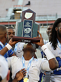 Armwood Hawks quarterback Darryl Richardson #6 kisses the trophy after the Florida High School Athletic Association 6A Championship Game at Florida's Citrus Bowl on December 17, 2011 in Orlando, Florida.  Armwood defeated Miami Central 40-31.  (Photo By Mike Janes Photography)