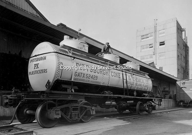 Pittsburgh PA:  Pittsburgh Coke and Chemical railroad car being filled up at the plant on Neville Island.   Plasticizers are used for the production of flexible PVC products such as cables, pipes and hoses, leather cloth, shoes, film for packaging.