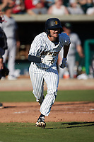 Alika Williams (6) of the Charleston RiverDogs hustles down the first base line against the Augusta GreenJackets at Joseph P. Riley, Jr. Park on June 27, 2021 in Charleston, South Carolina. (Brian Westerholt/Four Seam Images)