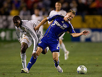 LA Galaxy forward Edson Buddle (14) and Kansas City Wizards defender Michael Harrington (2) collide during the second half of a MLS match. The LA Galaxy defeated the Kansas City Wizards 3-1 at Home Depot Center stadium in Carson, Calif., on Saturday, May 24, 2008.