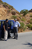 Pictured: Pathologist Nikos Karakoukis (R) arrives at the scene in Ikaria, Greece. Thursday 08 August 2019<br /> Re: Rescuers searching for  British scientist Natalie Christopher, 35, who disappeared on the  island of Ikaria, Greece have found her body at the bottom of a ravine.<br /> She was found less than a mile from the hotel in the Kerame area where she was on holiday with her Cypriot partner.<br /> Emergency service staff said that a large rock had dislodged as she fell, causing multiple head injuries.<br /> The woman's body will be kept overnight at the spot so a coroner can examine it on Thursday morning.