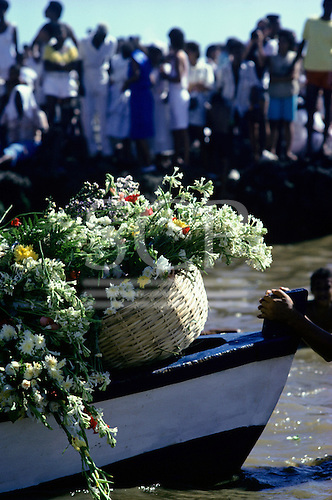 Salvador, Bahia, Brazil. Boat carrying offerings of baskets of flowers out to sea; Festival of Iemanja.