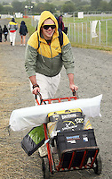 08/07/'10 A fan arrives carrying a car battery for power pictured arriving at Punchestown, Co. Kildare this evening for the start of the Oxegen Festival 2010...Picture Colin Keegan, Collins, Dublin