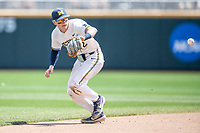 Michigan Wolverines shortstop Jack Blomgren (2) fields a ground ball during Game 11 of the NCAA College World Series against the Texas Tech Red Raiders on June 21, 2019 at TD Ameritrade Park in Omaha, Nebraska. Michigan defeated Texas Tech 15-3 and is headed to the CWS Finals. (Andrew Woolley/Four Seam Images)