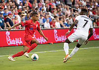 KANSAS CITY, KS - JUNE 26: Reggie Cannon #14 attempts to make a move on Jose Rodriguez #7 during a game between Panama and USMNT at Children's Mercy Park on June 26, 2019 in Kansas City, Kansas.