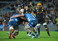 Chiefs' Sean Wainui is tackled during the Super Rugby Aotearoa match between the Blues and Chiefs at Eden Park in Auckland, New Zealand on Saturday, 1 May 2021. Photo: Dave Lintott / lintottphoto.co.nz