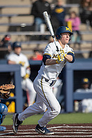 Michigan Wolverines first baseman Jimmy Kerr (15) follows through on his swing against the San Jose State Spartans on March 27, 2019 in Game 1 of the NCAA baseball doubleheader at Ray Fisher Stadium in Ann Arbor, Michigan. Michigan defeated San Jose State 1-0. (Andrew Woolley/Four Seam Images)
