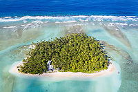 """Seen from above, it's easy to see why the Southwest Pacific country of Tuvalu has been identified as one of the world's most vulnerable nations to climate change. The country is made up of a collection of small islands and coral atolls, totalling only 27 square kilometres, scattered over 500,000 square kilometres of ocean. The highest point throughout the country is only 5 metres above sea level, resulting in special vulnerability to sea level rise. According to the Tuvaluan government, """"since 1993, sea level near Tuvalu has risen about 5mm per year; this is larger than the global average."""" Other challenges face the country including drought, ocean acidification and waste problems. Tuvalu. March, 2019."""