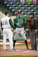 Great Lakes Loons coach Gil Velazquez (21) during the lineup exchange with Anthony Contreras (10) and umpire Luis Hernandez before the first game of a doubleheader against the Fort Wayne TinCaps on May 11, 2016 at Parkview Field in Fort Wayne, Indiana.  Great Lakes defeated Fort Wayne 3-0.  (Mike Janes/Four Seam Images)