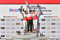 #60 Roush Performance / KohR Motorsports, Ford Mustang GT4, GS: Nate Stacy, Kyle Marcelli celebrates the win on the podium