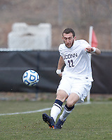 University of Connecticut defender Max Wasserman (22) clears the ball. .NCAA Tournament. Creighton University (blue) defeated University of Connecticut (white), 1-0, at Morrone Stadium at University of Connecticut on December 2, 2012.