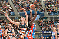 6th June 2021; Ken Rosewall Arena, Sydney, New South Wales, Australia; Australian Suncorp Super Netball, New South Wales, NSW Swifts versus Giants Netball; Samantha Wallace of NSW Swifts catches the ball under pressure from April Brandley of the Giants Netball