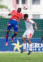 Jake Beckford (7) of Panama goes up for a header with Eric Francisco (2) of Costa Rica during the quarterfinals of the CONCACAF Men's Under 17 Championship at Catherine Hall Stadium in Montego Bay, Jamaica. Panama defeated Costa Rica, 1-0.
