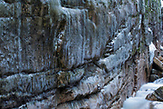 The icy wall of Flume Gorge in Franconia Notch State Park of New Hampshire USA during the winter months.