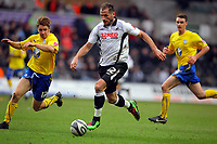 ATTENTION SPORTS PICTURE DESK<br /> Pictured: Shefki Kuqi of Swansea (C) against James O'Connor pf Sheffield Wednesday (L)<br /> Re: Coca Cola Championship, Swansea City Football Club v Sheffield Wednesday at the Liberty Stadium, Swansea, south Wales. Saturday 13 Marchy 2010