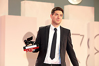 """VENICE, ITALY - SEPTEMBER 11: Director David Adler poses with the Best VR Story Award for """"End Of Night"""" at the awards winner photocall during the 78th Venice International Film Festival on September 11, 2021 in Venice, Italy."""