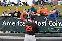 First baseman Christian Walker (23) of the Delmarva Shorebirds signs autographs before in a game against the Greenville Drive on Saturday, April 27, 2013, at Fluor Field at the West End in Greenville, South Carolina. Greenville won, 5-4. (Tom Priddy/Four Seam Images)