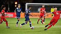 LAKE BUENA VISTA, FL - JULY 26: Ismael Tajouri-Shradi of New York City FC dribbles across midfield while pursued by Jayden Nelson of Toronto FC and Michael Bradley of Toronto FC during a game between New York City FC and Toronto FC at ESPN Wide World of Sports on July 26, 2020 in Lake Buena Vista, Florida.