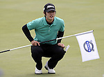 SUZHOU, CHINA - APRIL 17:  Kim Do-hoon of Korea holds the flag on the 2nd green during the Round Three of the Volvo China Open on April 17, 2010 in Suzhou, China. Photo by Victor Fraile / The Power of Sport Images