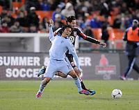 Sporting Kansas City midfielder Roger Espinoza (15) gets fouled by D.C. United defender Dejan Jakovic (5) Sporting Kansas City defeated D.C. United  1-0 at RFK Stadium, Saturday March 10, 2012.
