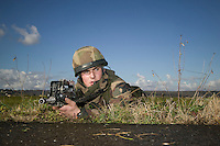 A member of the French Foreign Legion lies in position after jumping over the airport of Tarbes, France, during a full scale multi-force exercise, 11 December 2007.