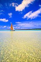 Catamaran sailing off an uninhabited island in Aitutaki Lagoon, Cook Islands, in the South Pacific.