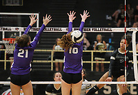 Trinity Hamilton of Bentonville with the kill through the blocks of Meg Gebhart (21) and Madeline Lafata (16)  of Fayetteville on Thursday, Oct.  7, 2021, during play at Tiger Arena in Bentonville. Visit nwaonline.com/211008Daily/ for today's photo gallery.<br /> (Special to the NWA Democrat-Gazette/David Beach)