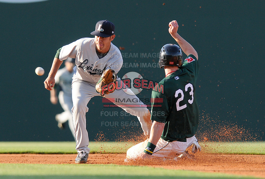 Jeremy Hazelbaker (23) of the Greenville Drive is out at second attempting to steal as Lexington Legends shortstop Jiovanni Mier takes the throw in a game on April 25, 2010, at Fluor Field at the West End in Greenville, S.C. Photo by: Tom Priddy/Four Seam Images