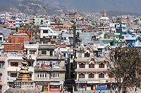 Bodhnath, Nepal.  Stupa in Background, Urban Housing in front.