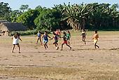 Pará State, Brazil. Aldeia Apyterewa (Parakana). Girls playing football.