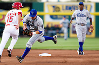 James Cesario (9) of the Tulsa Drillers fields a ground ball during a game against the Springfield Cardinals on April 29, 2011 at Hammons Field in Springfield, Missouri.  Photo By David Welker/Four Seam Images.