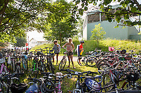 Kids arrive at the Boys and Girls club by  bike. The club is like a day camp with boating, athletic activities and games for kids. Bicycles are one of the  main modes of transportation on the grounds. Cars are restricted on the grounds. June 27, 2014. Photo by Brendan Bannon.