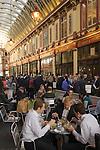 Leadenhall Market City of London EC3 UK. City office workers having lunch.