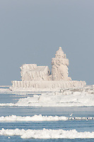 The Cleveland Harbor West Pierhead Light covered by frozen layers of ice.  The lighthouse was encased in ice by crashing waves in frigid air temperatures during mid-December.