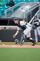 Coastal Carolina Chanticleers catcher Casey Schroeder (10) chases after the baseball during the game against the Bryant Bulldogs at Springs Brooks Stadium on March 13, 2015 in Charlotte, North Carolina.  The Chanticleers defeated the Bulldogs 7-2.  (Brian Westerholt/Four Seam Images)