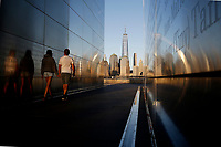 JERSEY CITY - NEW JERSEY - MARCH 26: People walk through the Empty Sky memorial while the One World Trade Center is seen during a sunset on March 26, 2021 in Jersey City. New York's tourism and its industries have been struck hard by the Covid-19 pandemic, with no more than 33% of people visited NYC in 2020, compared with 66 million in 2019, now the big apple hopes to welcome more than 36 million during year.(Photo by Emaz/VIEWpress)