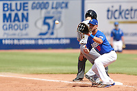 Brandon Hicks #12 of the Las Vegas 51s catches a pickoff throw at first base during a game against the Salt Lake Bees at Cashman Field on May 27, 2013 in Las Vegas, Nevada. Las Vegas defeated Salt Lake, 9-7. (Larry Goren/Four Seam Images)