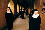 Sisters at St Mary at the Cross Edgware Abbey. Sisters walk back through the cloisters after Divine Office in the chapel. Edgware Middlesex UK 1980s 1989.