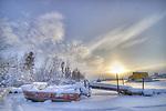 Boat under snow in Yellowknife Bay